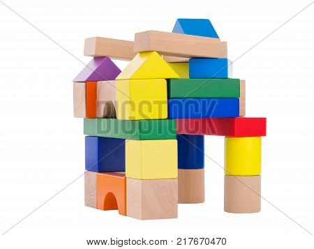 Cubic multi colored castle, lined up for a child, wooden toys, child development, at the top stands a blue triangle, view from the side, isolated on a white background.