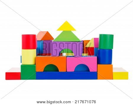 Wooden toys from which build children's houses, the development of a child, a cubical multi-colored castle, with towers, front view, isolated on a white background.