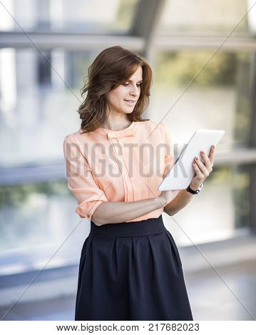 business woman with tablet.lifestyle. the woman head.technology and the Internet