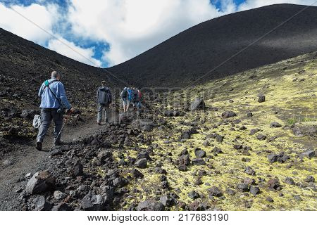 Kamchatka Peninsula, Russia - August 20, 2016: Tourists on excursions in places of Hiking trail climb to the North Breakthrough Great Tolbachik Fissure Eruption 1975