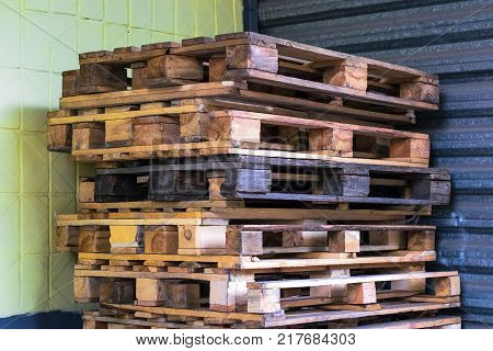Old wooden pallets in the supermarket warehouse. Texture of pallets