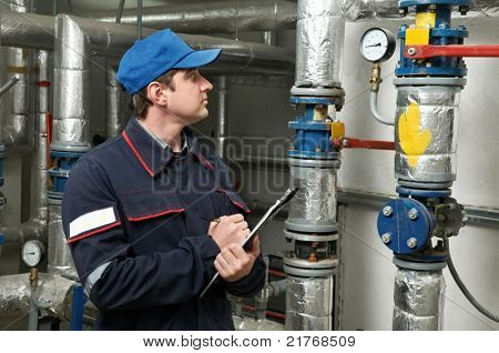 maintenance repairman engineer of heating system equipment in a boiler house poster