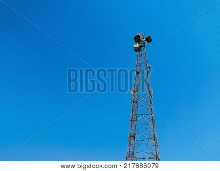 BLUE SKY WITH TELEVISION TOWER BROADCASTING SIGNAL