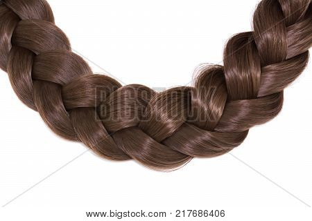 Women's hair isolated on white background. A brown braid of hair.