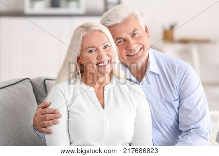 Mature couple in comfortable room