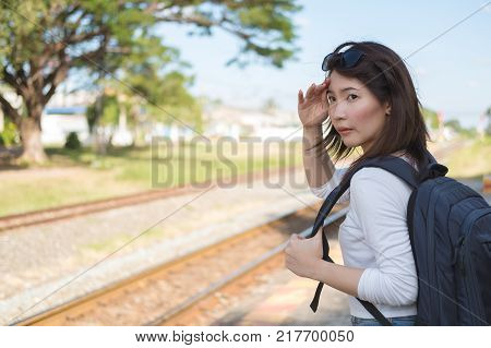 Young asia woman waiting a train at local railway station in Thailand, Travel and vacation concept.