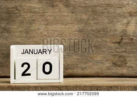White block calendar present date 20 and month January on wood background