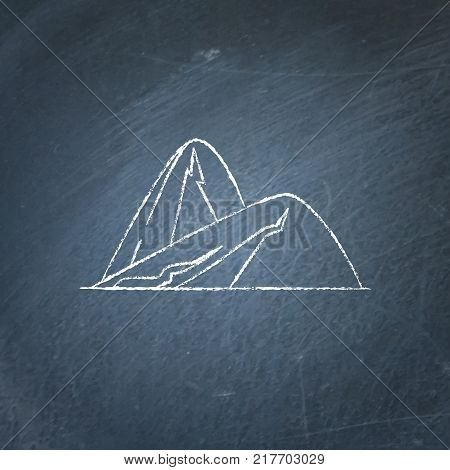 Sloping hills icon on chalkboard. Outline mountain symbol - chalk drawing on blackboard.