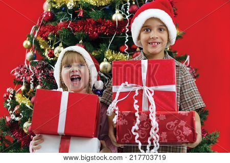 two child hold gifts in hand on Christmas evening
