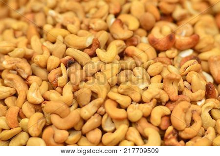 Background with stack of roasted peanuts on market