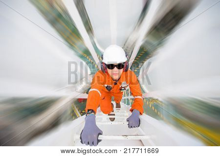 Engineering climb up to oil and gas process plant to observer and inspect gas dehydration processing in night shift daily operation activities offshore oil and gas occupational.