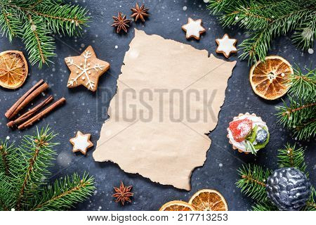 Christmas letter, wishlist or Christmas resolution mock up. Empty paper, spices, fir tree and snow composition. Top view and copy space