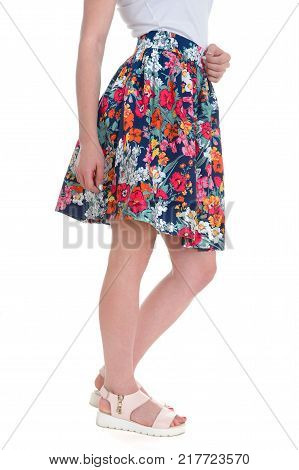 Woman legs in a skirt isolated on a white background