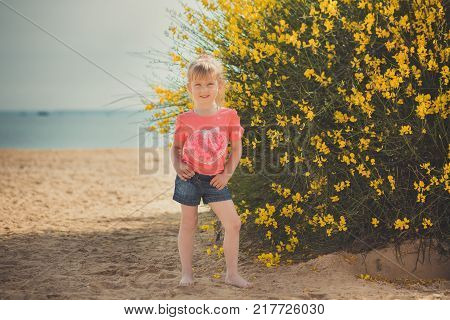 Blond Young Baby Girl Have Some Fun During Summer Vacation Holidays Posing Fashion Style Session Clo