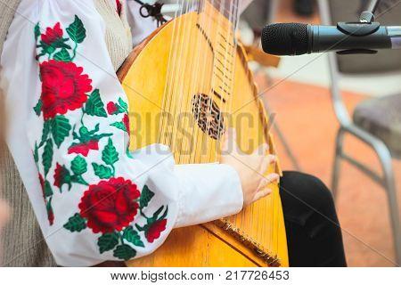 Woman playing music with balalaika. Lifestyle concept. Russian instrument. Folk music russian ensemble - woman playing the balalaika
