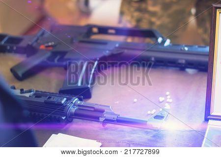 sub machine gun on the table master restorer in the interior gunsmith. poster