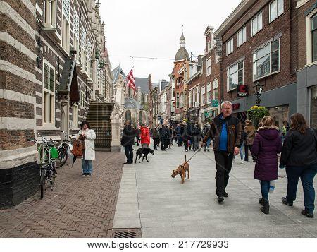 ALKMAAR NETHERLANDS - APRIL 21 2017: Popular Langestraat shopping street centre of Alkmaar Netherlands