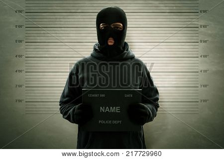 Mugshot of criminal masked thief wanted potrait