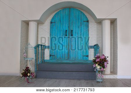 Beautiful front door in the house with an arch and two columns. Retro style.