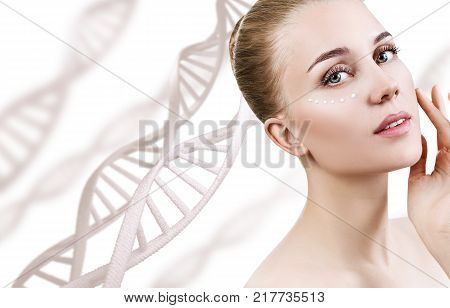 Young sensual woman in DNA chains over white background. Biochemistry skin concept. poster