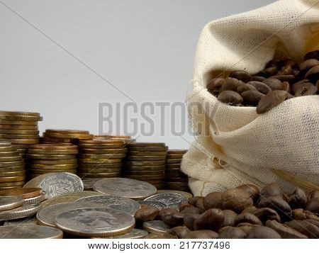 Coffe Beans With Coins Isolated On White Background