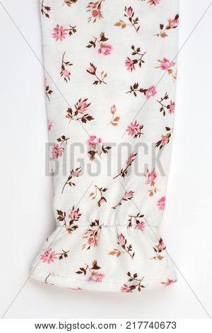 Detailed view on pajama sleeve. Snug lightweight cotton with flower pattern. Girls' sleepwear collection.
