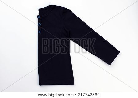Folded blue pullover on white. Long sleeve, breast-pocket and button-up neck. Snug and comfy pajama top.