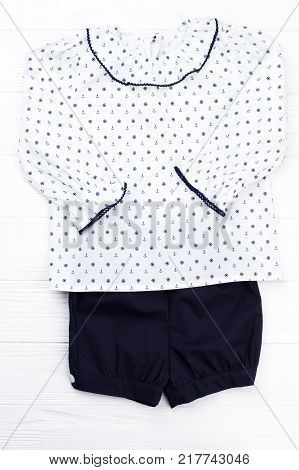 Sailor pajama set on white. Navy shirts and white top with ruffles. Perfect for kindergarten sleeping.