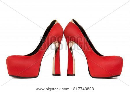 Woman red shoe on white background. Red female shoe on high heel on white background in profile. Woman fashion accessory.