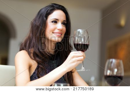 Woman drinking wine. Beautiful young woman drinking wine