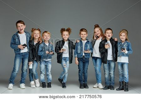 The studio shot of group of children with mobile phones
