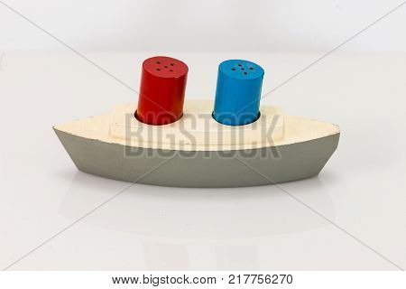 a wooden ship with smoke stacks salt and pepper shakers