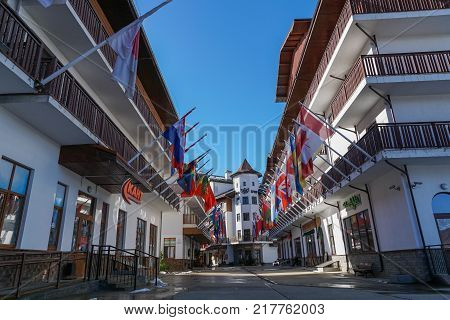 Rosa Khutor, Sochi , Russia - April 26 2017: Street in the Olympic Village in Rosa Khutor with all national flags, Rosa Khutor, Krasnaya Polyana, Sochi , Russia.
