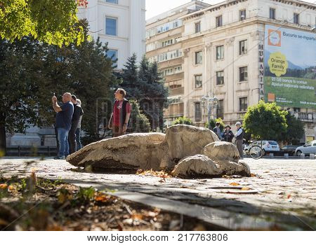 Bucharest Romania October 10 2017 : Lying sculpture on the Revolution Square in Capital city of Romania - Bucharest