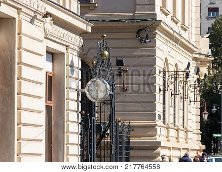 Bucharest Romania October 10 2017 : Large clock with arrows on the facade of the building in the Revolution Square in Capital city of Romania - Bucharest