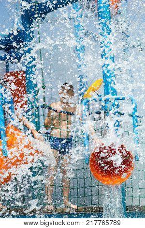 happy boy having fun in aqua park
