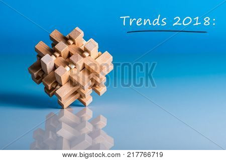 TRENDS 2018. New trend at business innovation technology and other areas. Blue background with macro view of brain teaser and empty space for text, Mockup.
