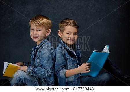 The studio shot of children with books