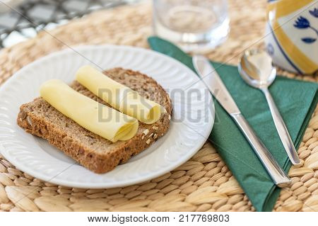 Morning breakfast of Dutch cheese and black bread. Close up