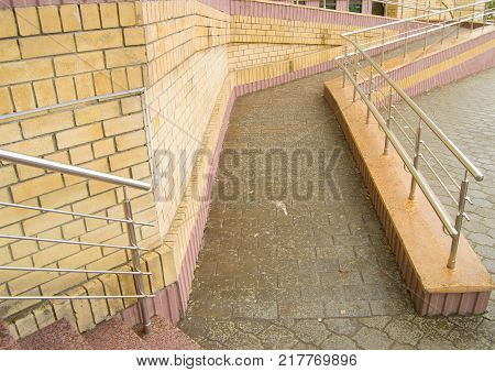 Ramp way for the movement of wheelchair users at the entrance to the building.