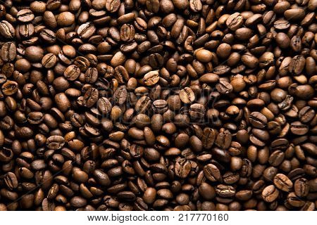 Fresh roasted arabica coffee beans background. Beautiful arabica coffee beans has very strong smell and excellent taste!Every coffee bean is unique.