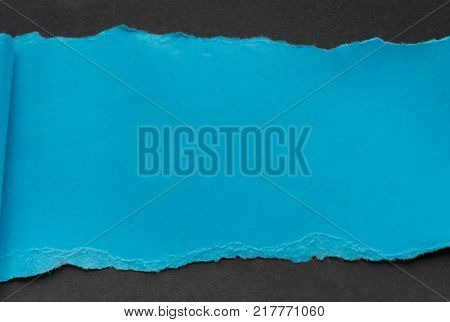 blue rip paper isolated on black background with space for text