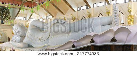 Panoramic image of the biggest white Italian marble reclining Buddha Wat Pa Phu Kon temple Udon Thani Thailand