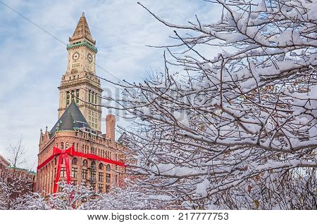 Christmas in Boston, USA. large red ribbon on The Flour and Grain Exchange Building