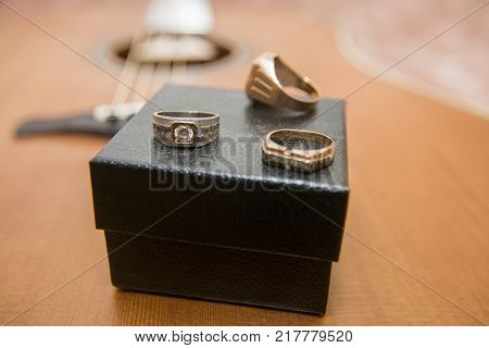 WatchesWrist watch, gold ring, bracelet and guitar in the background, gold ring, bracelets and guitar