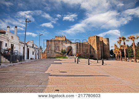 Miglionico, Matera, Basilicata, Italy: the town square with the medieval castle (Castello del Malconsiglio)