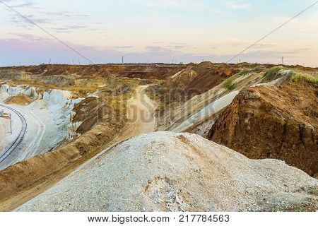 Clay and chalk slopes of the quarry for extraction of minerals. Hilly scape.