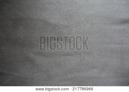 Grey artificial suede fabric surface from above