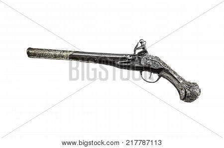 Ancient pistol or musket isolated on a white background.