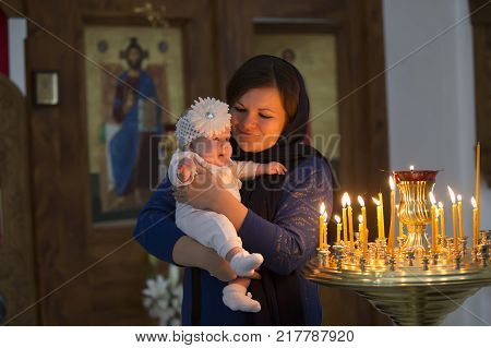 Belarus the city of Gomel on October 25 2017. Church of the farm. Child in the arms of the mother.Baptism of the baby. Accept religion. Newborn in the church.